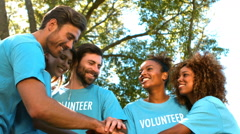 Group of volunteer forming hands stack Stock Footage