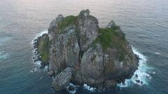 Birds Eye View Over Gigantic Brazilian Rock in Ocean at Sunset Stock Footage