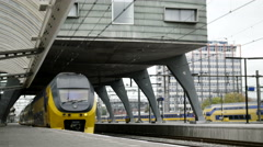 Amsterdam, the Netherlands. 18 oct 2016. Yellow train leaving railway station Stock Footage