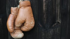 Boxing gloves hanging on old wooden door. Stock Footage
