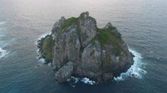 Birds Eye View Over Gigantic Brazilian Rock in Ocean at Sunset 002 Stock Footage