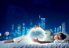 Boy dreaming before sleep Kuvituskuvat