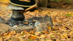 Old, vintage cezve and cup of coffee (tea) on the campfire. Slider shot. Stock Footage