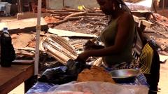 Woman caju seller  city market -Bandim Guinea Africa Stock Footage