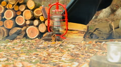 Man waiting for his coffee (tea) near the campfire. Slider shot. Stock Footage