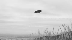 FLYING SAUCER FLIES OVER SOUTHERN CALIFORNIA MOUNTAINS Stock Footage