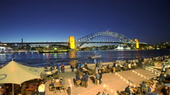 Moving shot of people dining at outdoor restaurants in Sydney, Australia Stock Footage