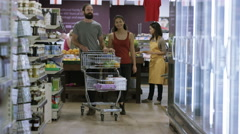 4K Happy couple shopping together in the grocery store Stock Footage