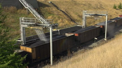 Railroad, coal train and coal dust water-based sealant station Stock Footage