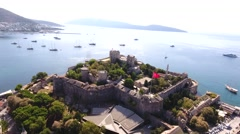 Castle marina aerial yacht Turkish flag drone shot business boat harbor Bodrum Stock Footage