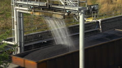 Railroad, coal train and coal dust water-based sealant station, CU Stock Footage