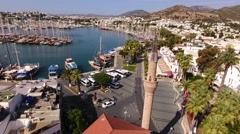 Bodrum city center, white houses, marina, mosque and minaret drone shot Stock Footage
