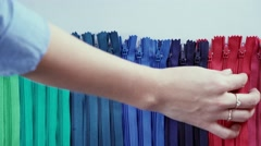 Female hand correcting zippers for clothes. Orderliness Stock Footage