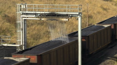 Railroad, coal train and coal dust water-based sealant station, angle Stock Footage