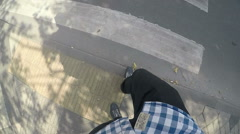 Legs are at a pedestrian crossing Stock Footage