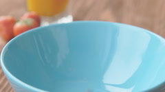 Corn balls pour in a bowl Stock Footage