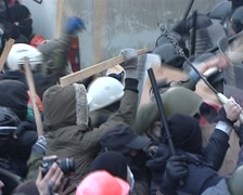 Protesters beat police by sticks Stock Footage