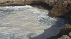 Sea foam, a grotto on the shore of the Atlantic Stock Footage