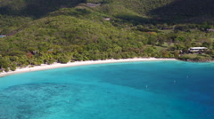 Aerial panning video of scott beach, Caneel Bay, St John Stock Footage