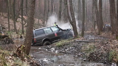 SUV got stuck in the mud in the forest, off-road Stock Footage