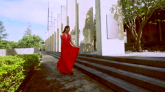 Beautiful lady in red dress Stock Footage