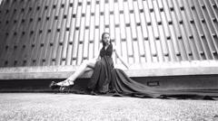 Beautiful lady in black dress Stock Footage