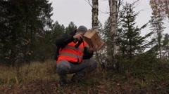 Ornithologe with bird nesting box Stock Footage