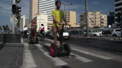 Group of tourists on a segway rides along the waterfront of the Mediterranean Se Stock Footage