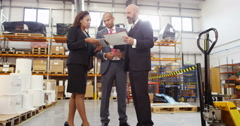 4K Businesswoman negotiating a deal with investors in factory warehouse Stock Footage