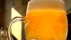 Bubbles are moving around at beer mug Stock Footage