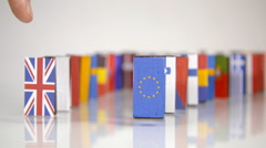 The Eu Dominos Fall. Flags of European Countries like a domino  falling down Stock Footage