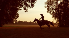 Woman horseback riding at sunrise in super slow motion Stock Footage
