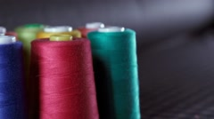 Sewing Threads On Spool. Colorful spools of thread in textile factory Stock Footage