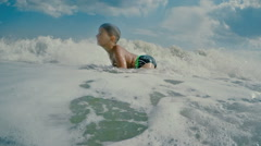Boy luxuriates in the waves Stock Footage