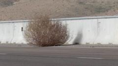 Tumbleweed on highway Stock Footage