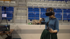 Young Woman in Virtual Reality Glasses. VR. Belarussian comic con. Minsk. 2016. Stock Footage
