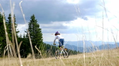 Low angle view of downhill mountain bikers Stock Footage