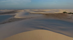Hikers in Vast Sand Dune Wilderness at Sunset Stock Footage