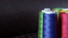 Shot of colorful rolls of woolen. Needlework, craft, sewing and tailoring Stock Footage