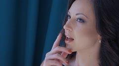 Close-up of seductive woman holding her fingers on her lips Stock Footage