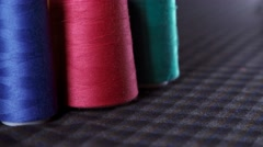 Spools of thread. Multi-colored thread. The ability to choose Stock Footage