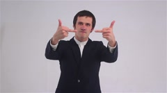 Angry Aggressive man showing Fuck you sign, the middle finger Stock Footage