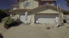 Aerial Drone Footage of home painters Stock Footage