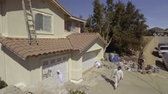 Aerial Drone Footage of house painters Stock Footage