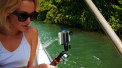 Young girl in a sunglasses travel by boat through Kalu Ganga river Stock Footage