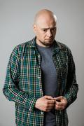 Portrait of resentful sad emotive man over beige background Stock Photos
