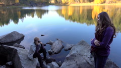 Model Asian Woman Poses For a Photo on a Background of Lake. Autumn Evening. Stock Footage