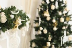 Christmas decorated room with a defocused tree and a mantelpiece Stock Photos