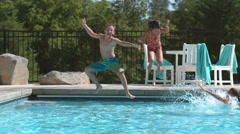 Kids jumping into pool in super slow motion Stock Footage