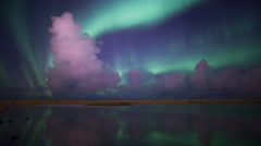 Bright green aurora purple clouds reflect calm water lake fantasy landscape 4k Stock Footage